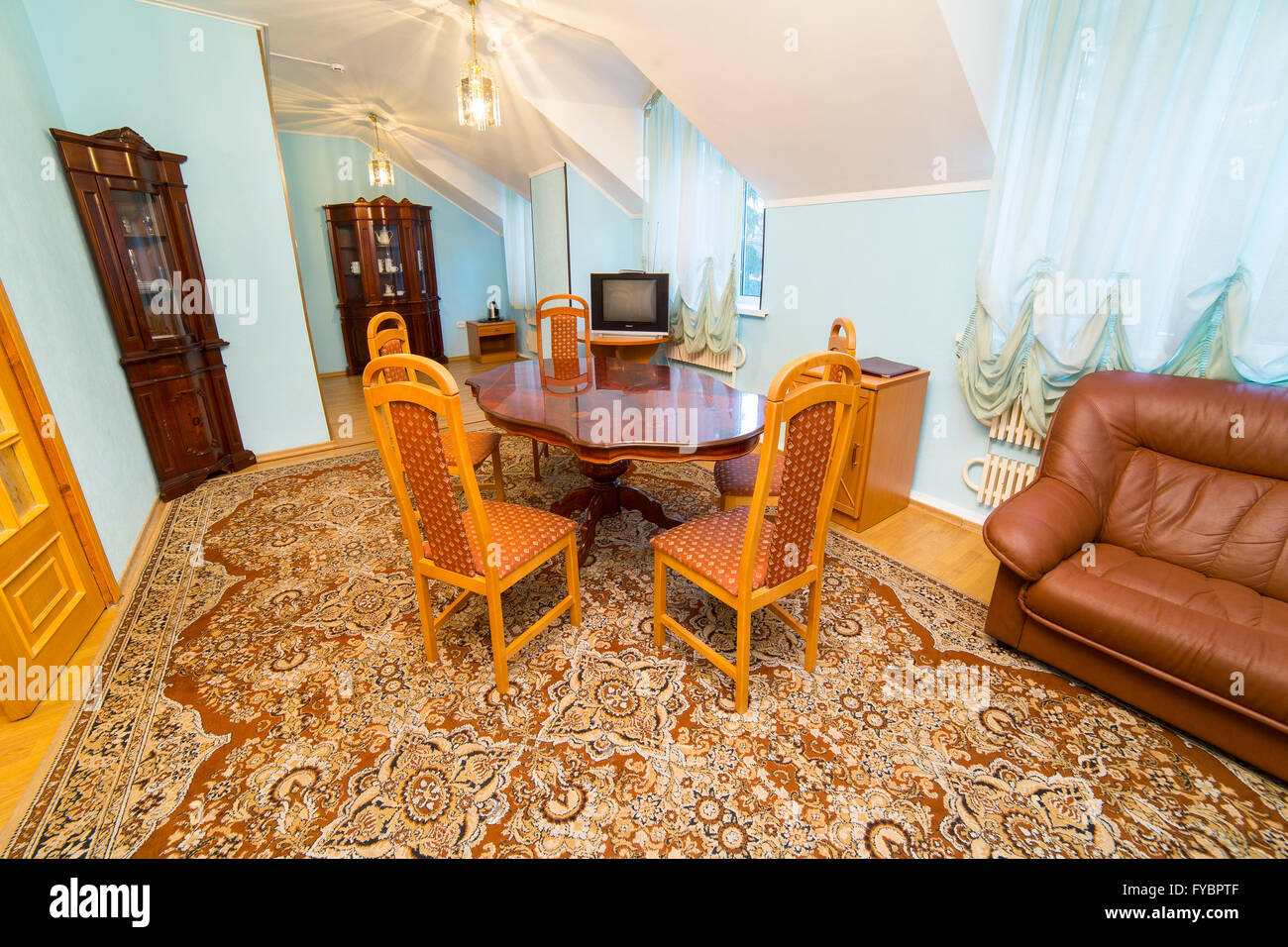 Hotel apartments interior in classic style with round table - Stock Image