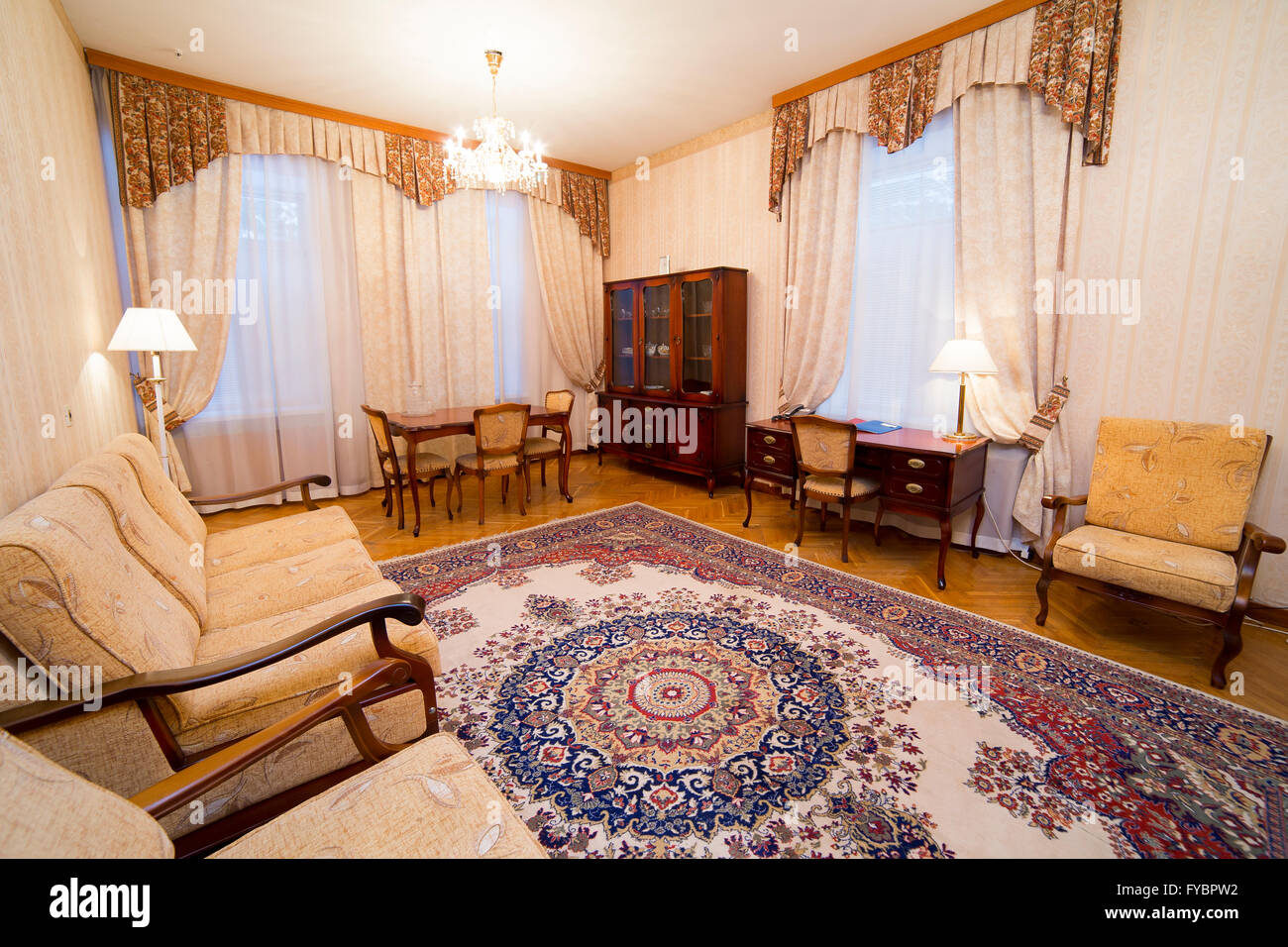 hotel luxury apartment interior in classic style with oriental carpet