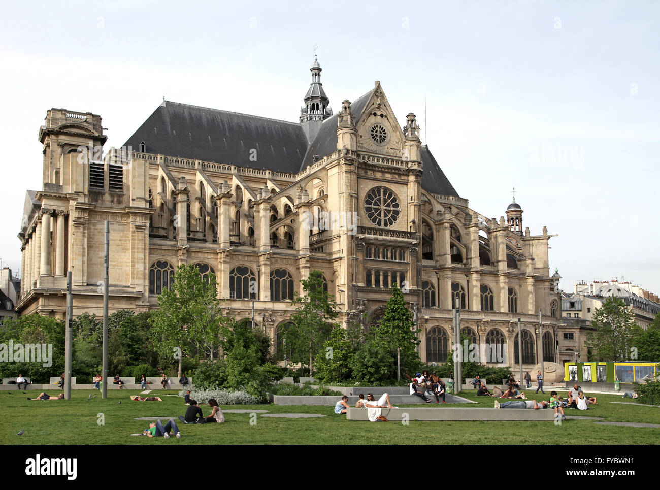 People relaxing.Church of St Eustache Eglise Saint-Eustache and the Nelson Mandela Garden.Paris France. Stock Photo