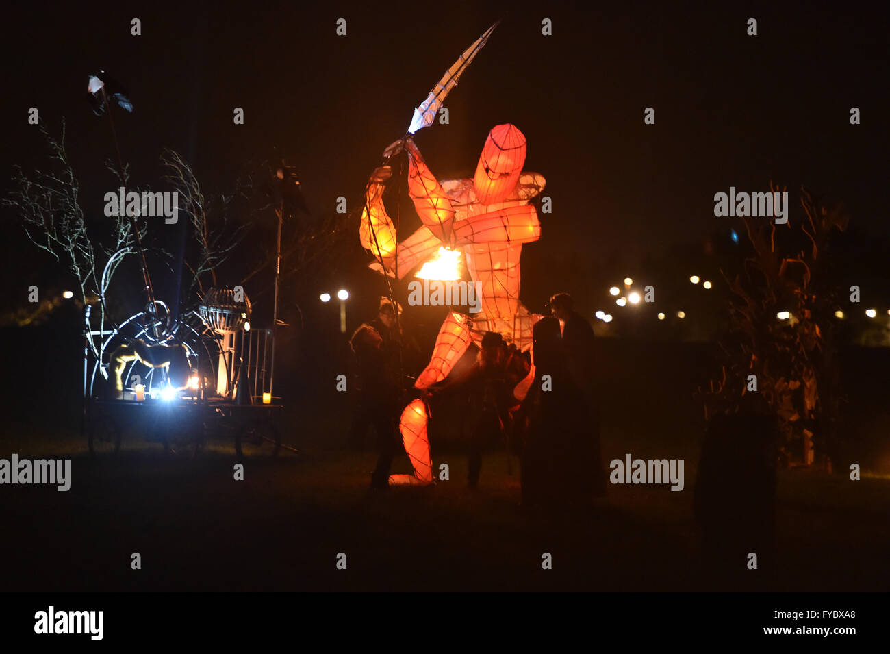 Fire Festival  Campbell Park Milton Keynes  Paraffinalia  Orange soldier marchs and attacks with sword - Stock Image
