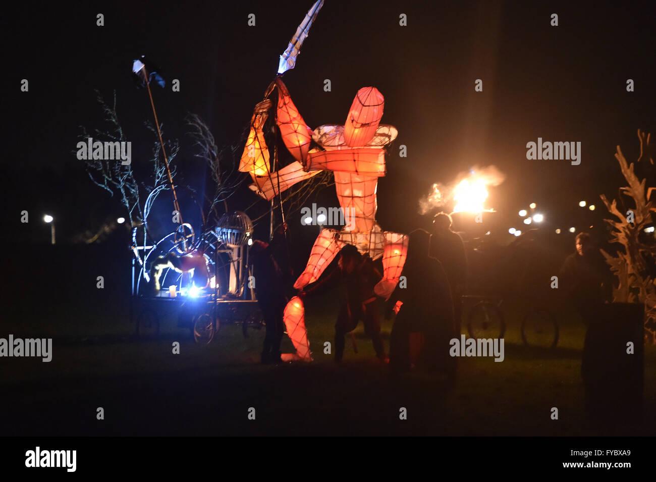 Fire Festival  Campbell Park Milton Keynes  Paraffinalia  Orange soldier marchs and attacks - Stock Image
