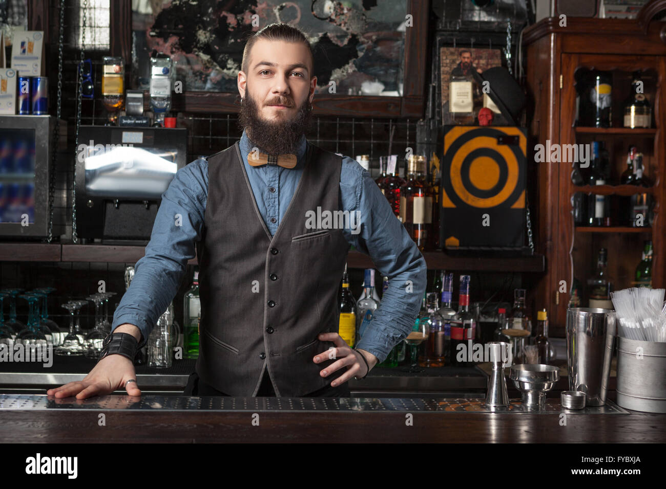 Barman at work on his workplace. - Stock Image