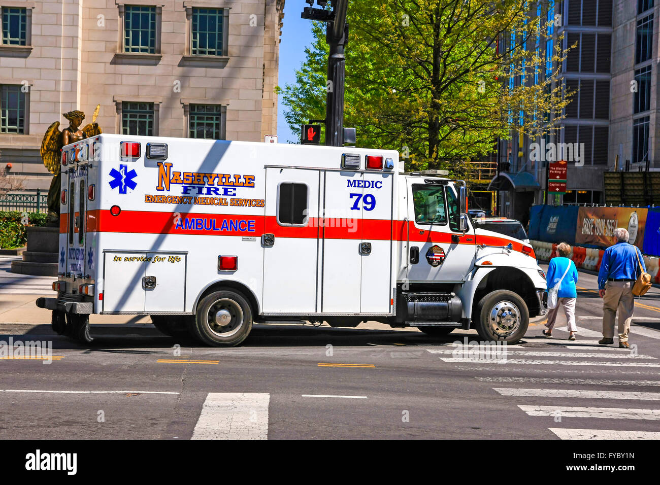 Nashville Fire Dept EMT ambulance attending an accident outside the Symphony building - Stock Image