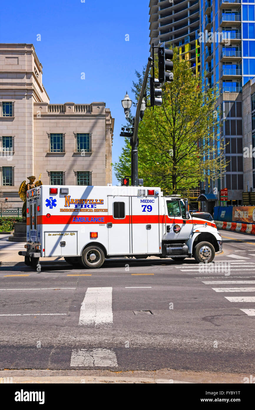 Nashville Fire Dept EMT ambulance attending an accident outside the Symphony building - Stock Image