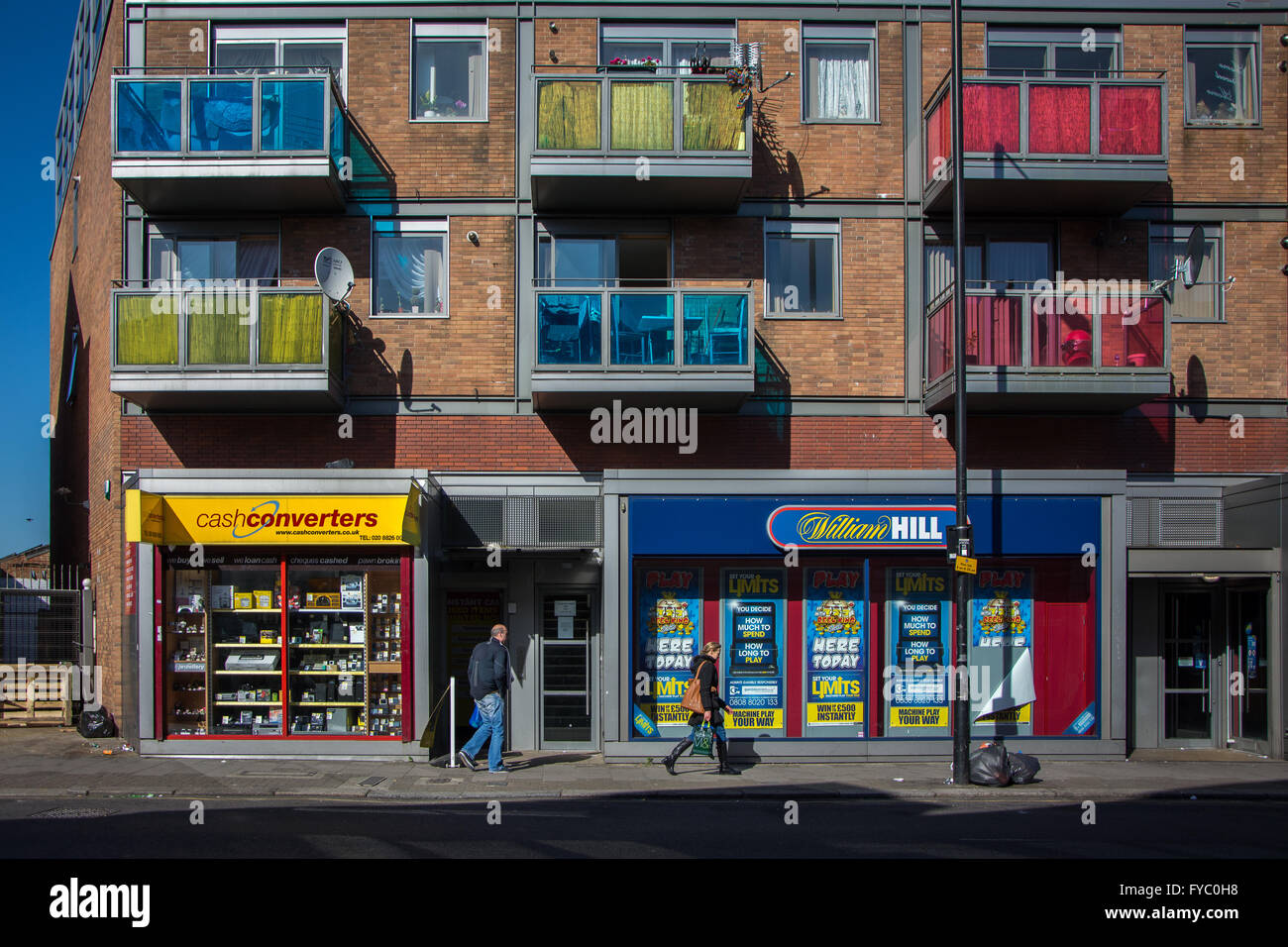 Pawn and betting shop + colourful flats,  Harringay, North London - Stock Image