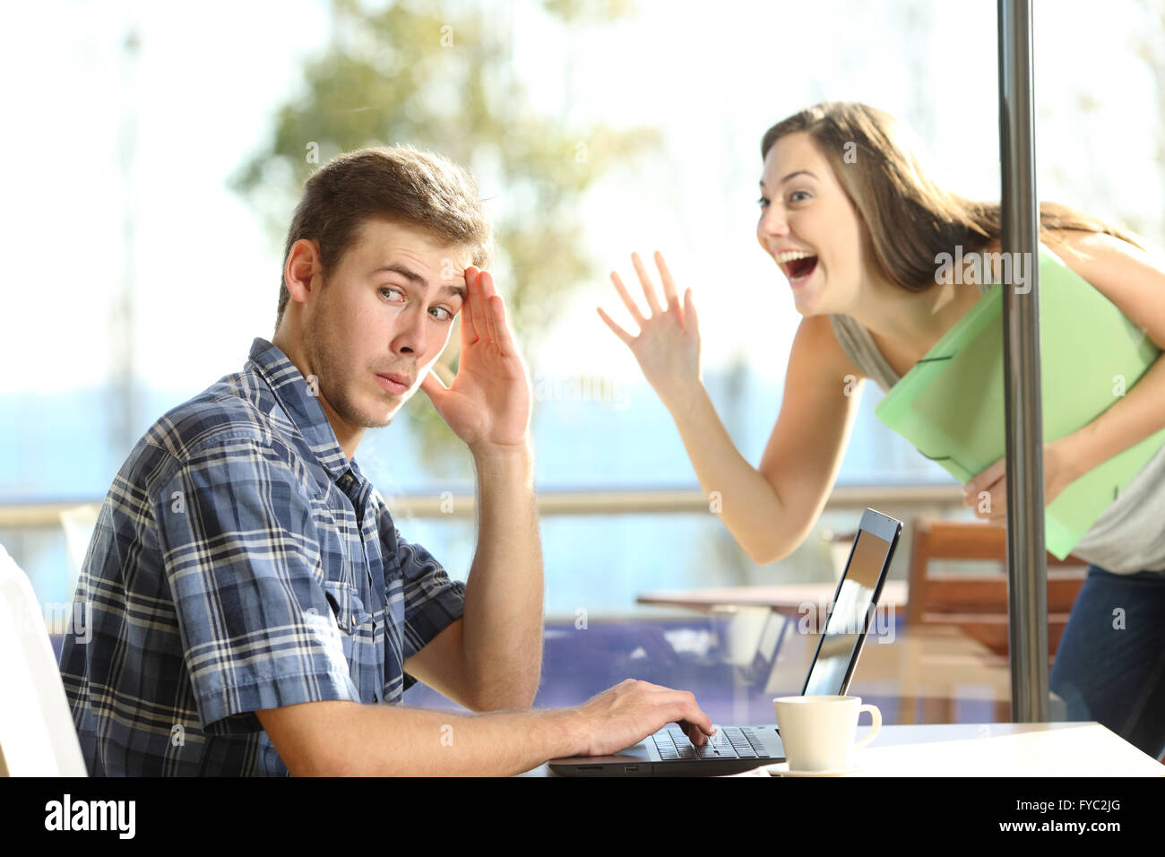 Man ignoring and rejecting to a stalker woman in a coffee shop - Stock Image