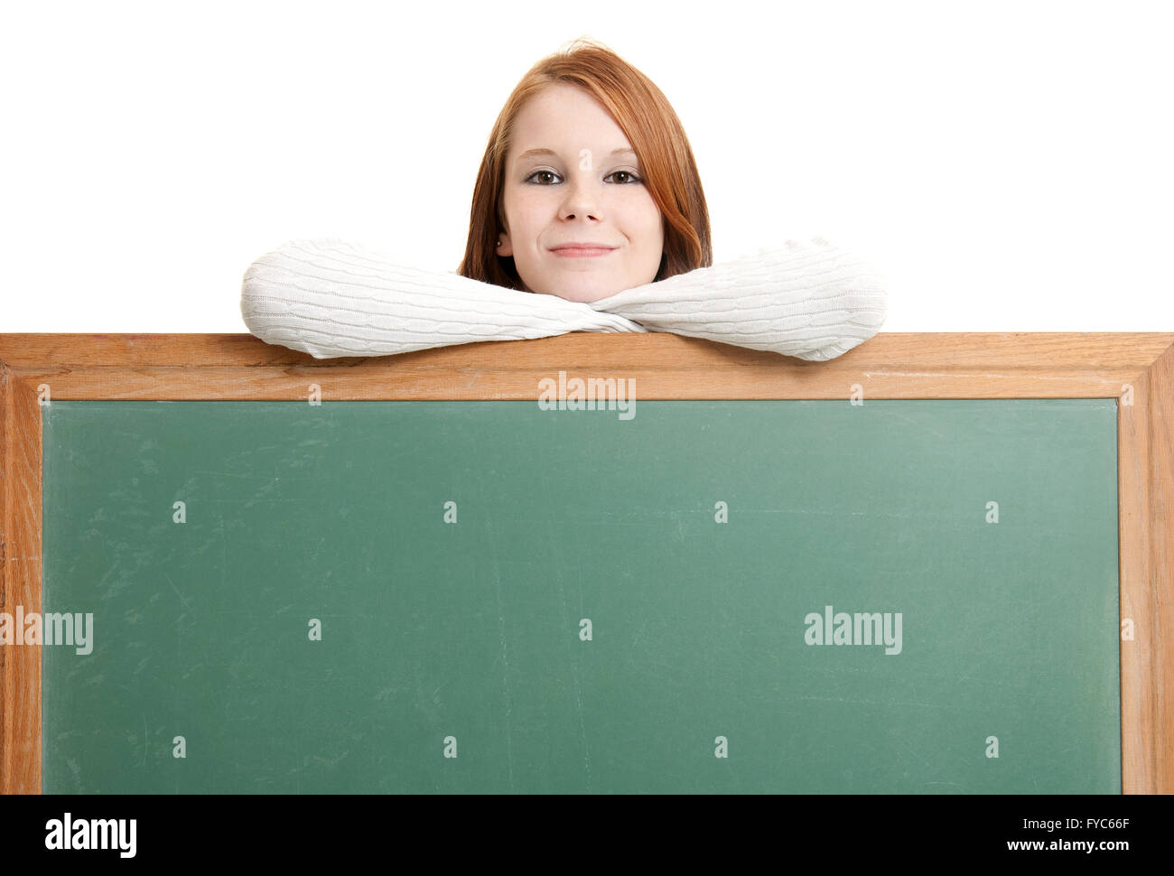 Cute teen with blank chalkboard Stock Photo