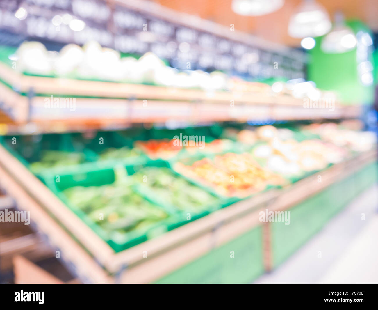 Blur of fresh fruits on shelf in supermarket. Shalow DOF. For healthy concept - Stock Image
