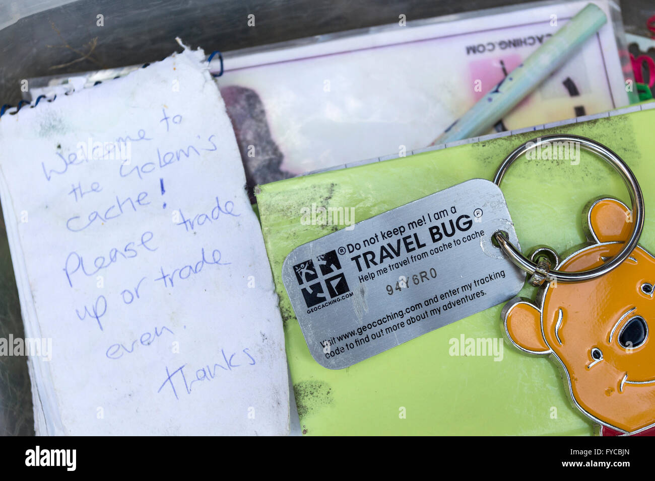 Contents of a Geocache Containing an Object Known as a Travel Bug Which is Moved from Cache to Cache Across the - Stock Image