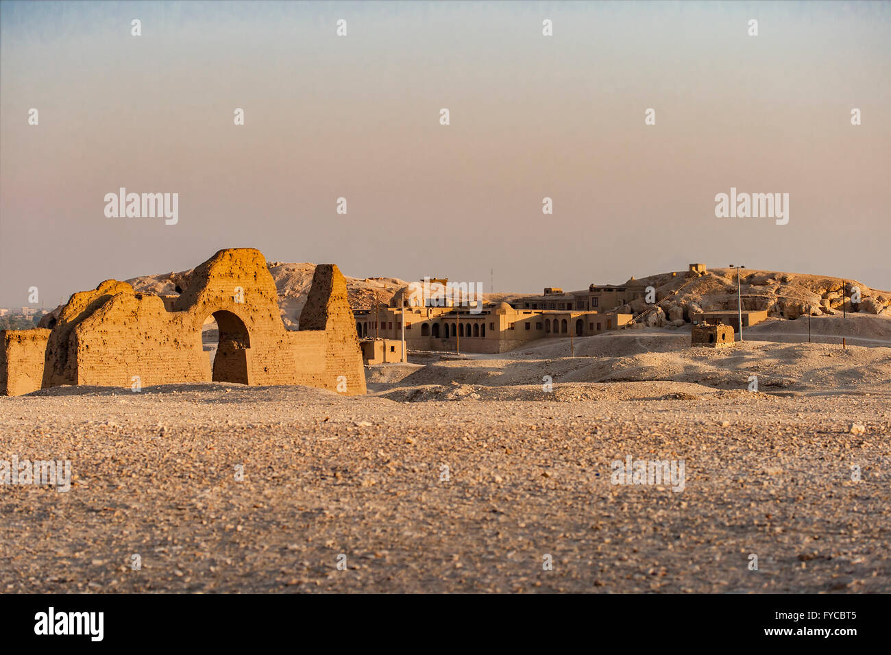 Image of ruins in the desert by Temple of Queen Hatsepsut, Egypt. - Stock Image