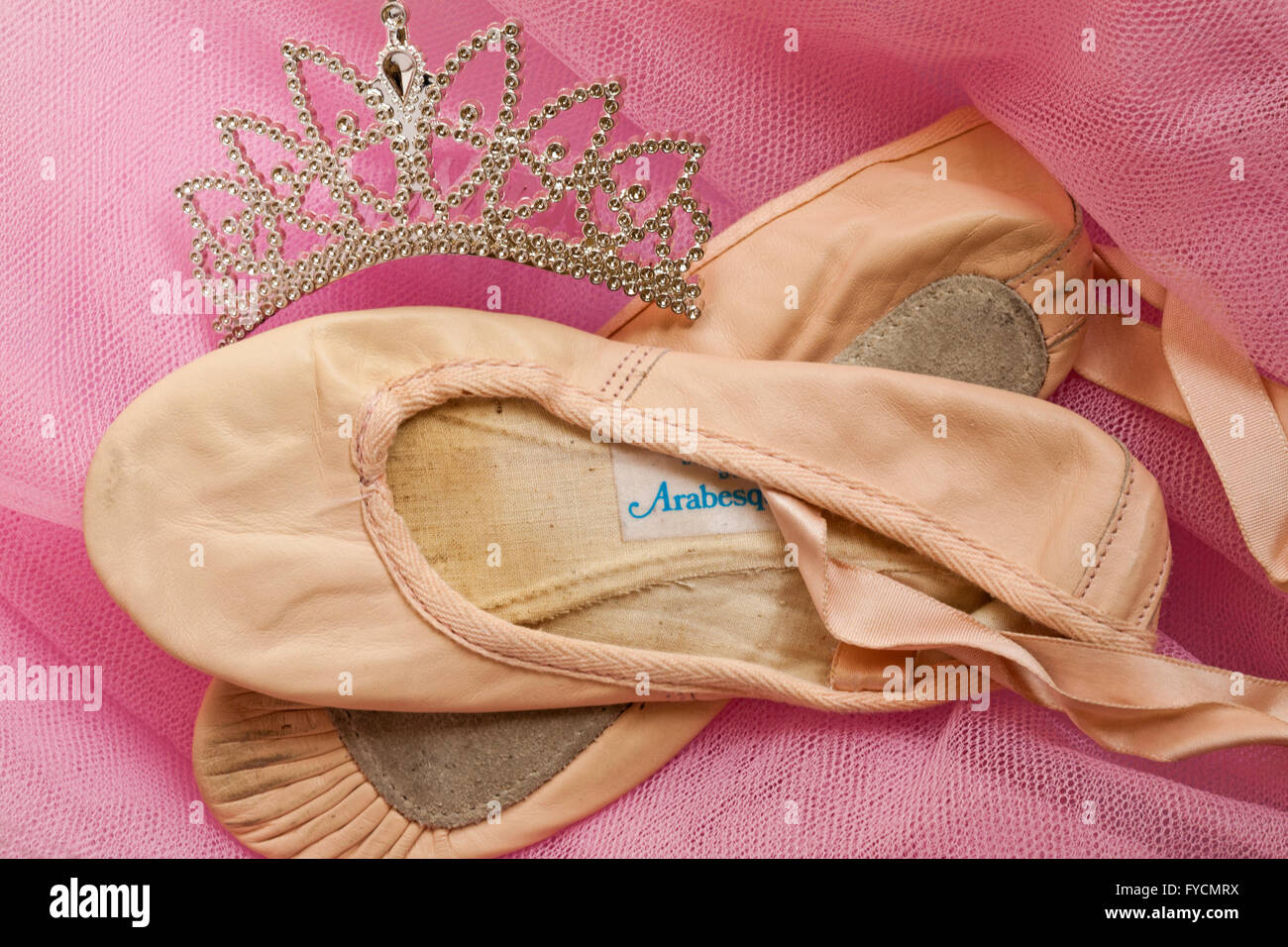 0ce3ddfc0 Pair of well worn and loved ballet shoes with tiara on pink tutu - Stock  Image
