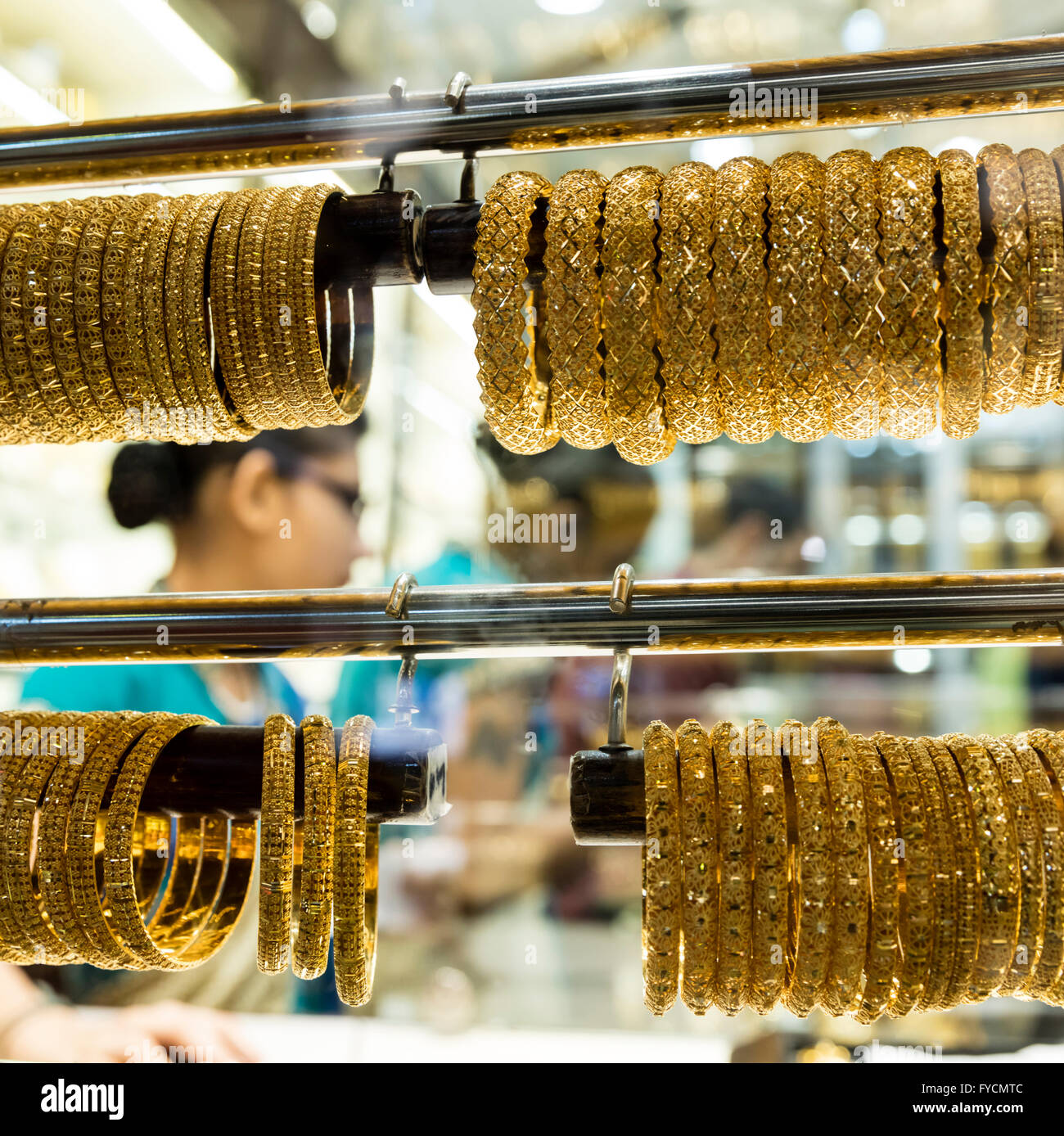 Racks of gold bracelets for sale on display in a shop window, Gold Souq, Al Ras, Dubai, UAE - Stock Image