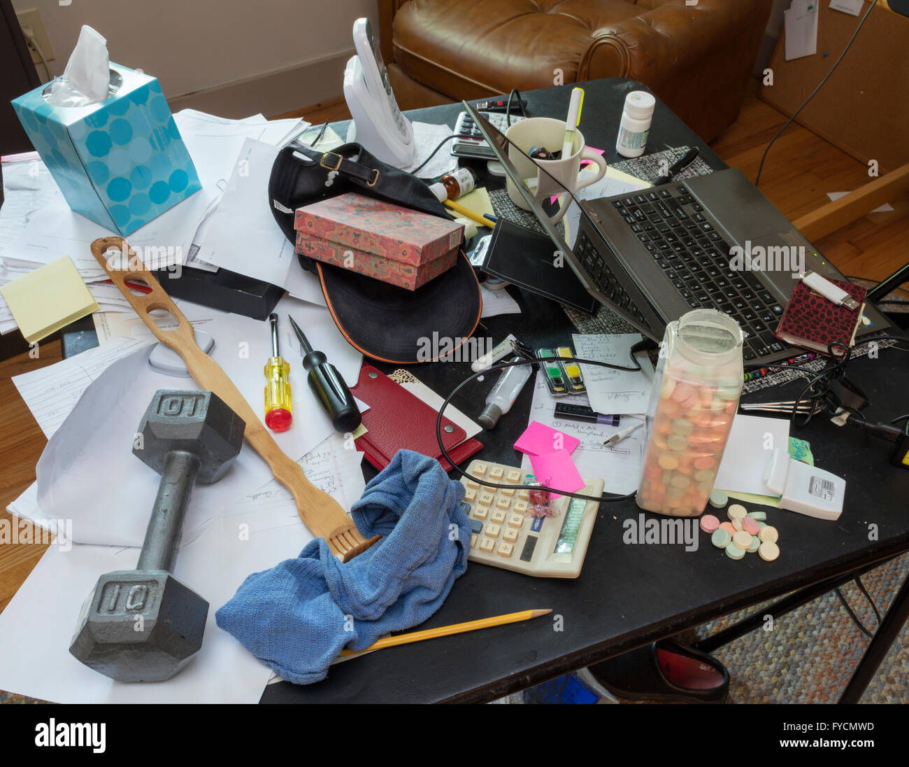Chaotic, messy desk - Stock Image