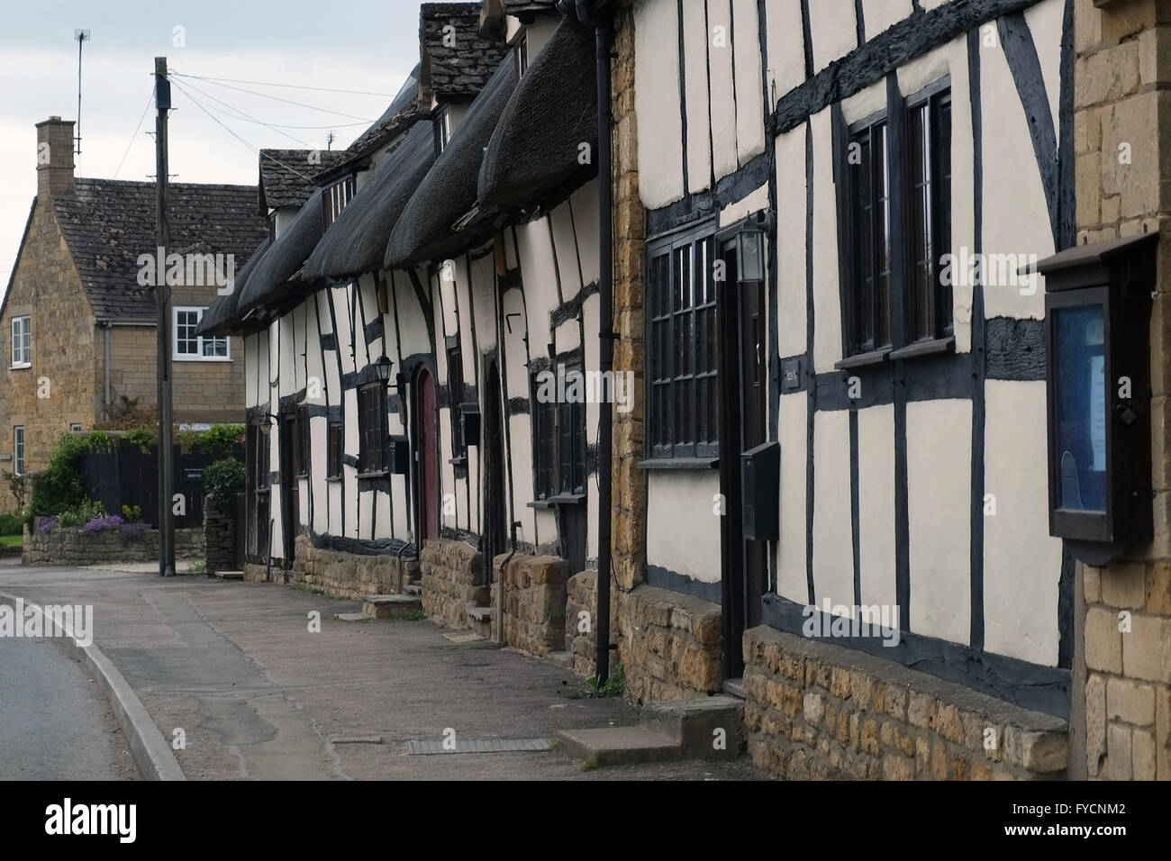 Row of thatched cottages on the High Street in Mickleton, Gloucestershire, England, UK. Stock Photo