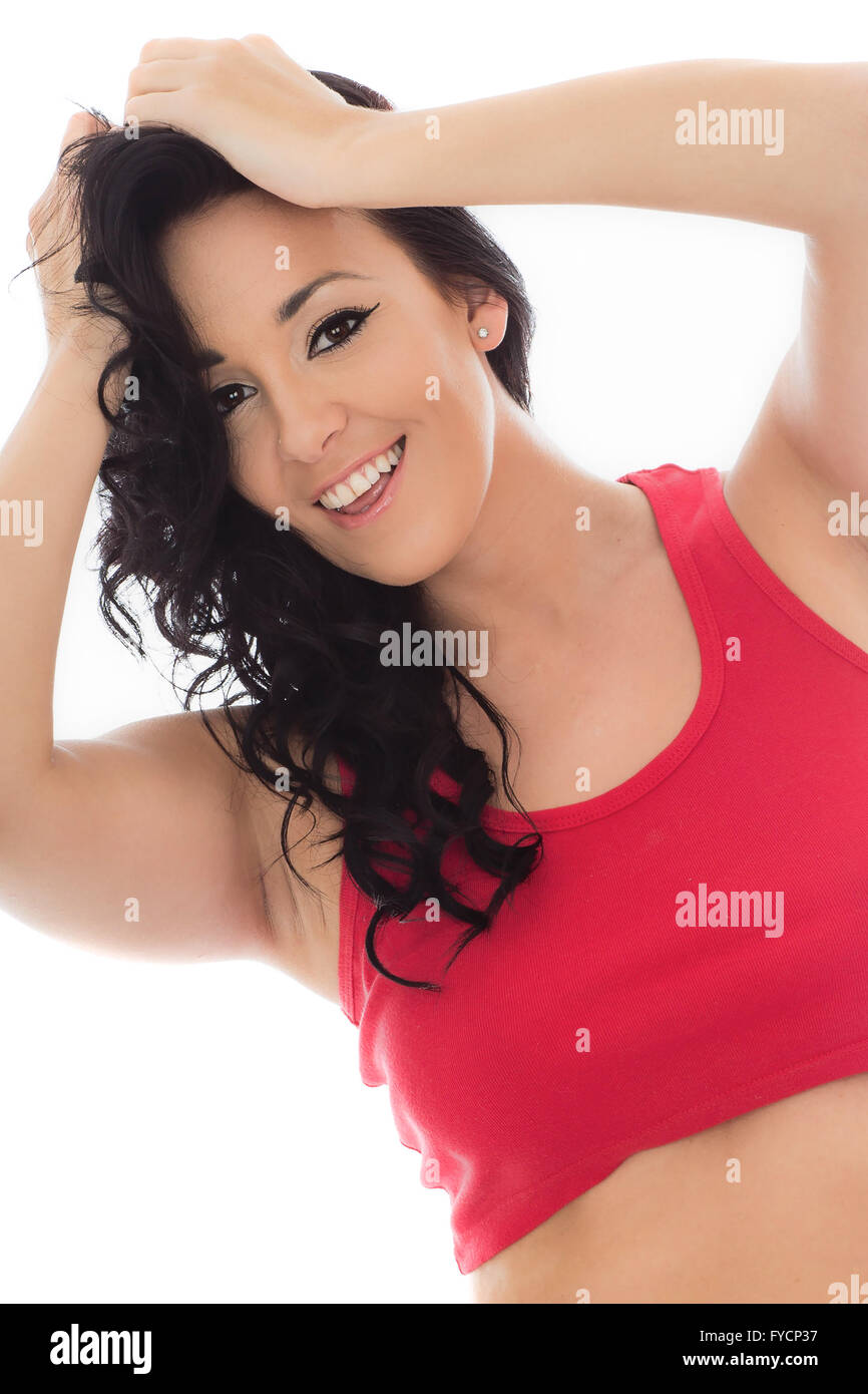 Attractive Happy Young Hispanic Woman Wearing A Red Vest Top Isolated Against A White Background - Stock Image