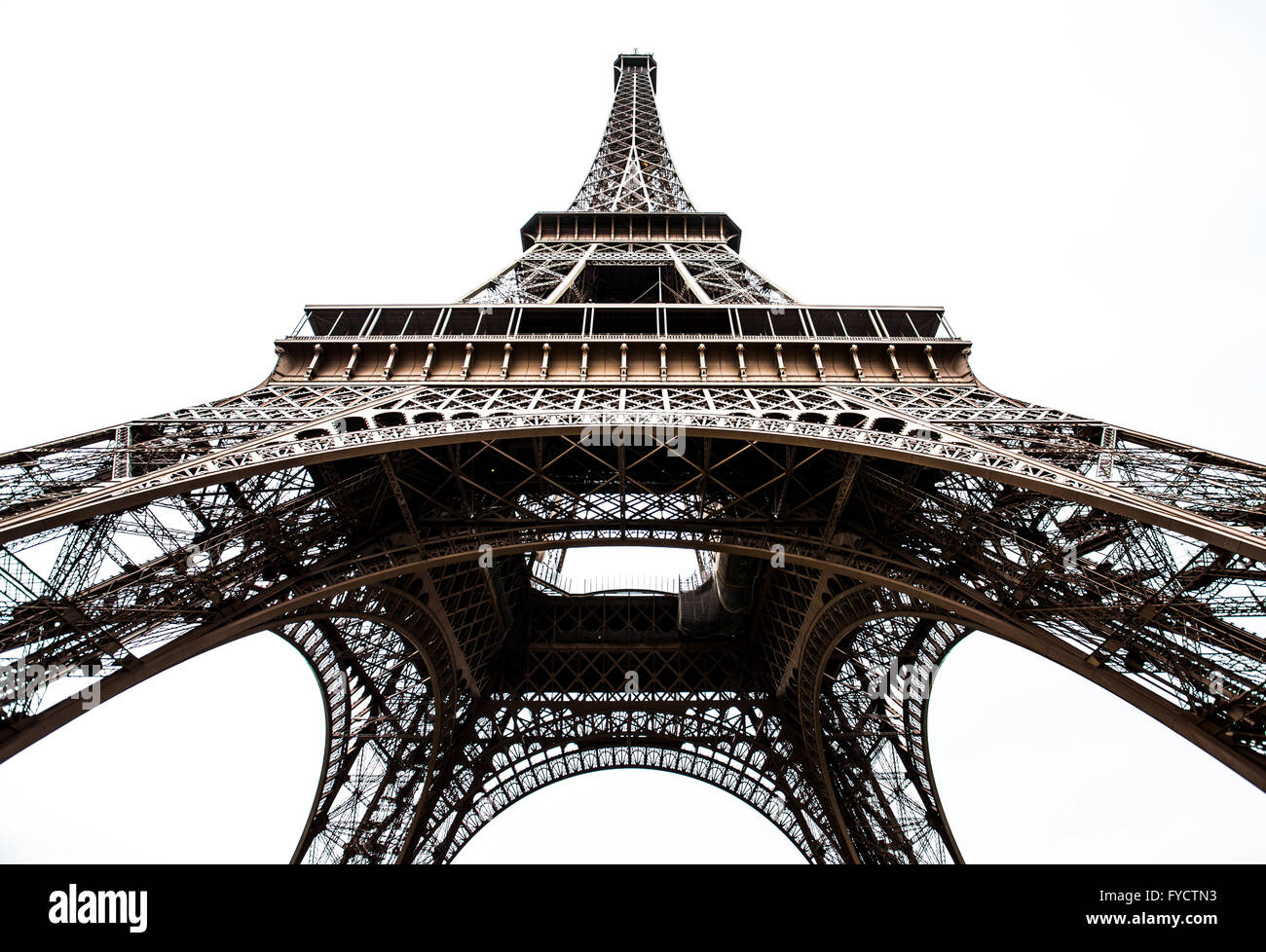 Looking up at the Eiffel Tower against a white background. - Stock Image