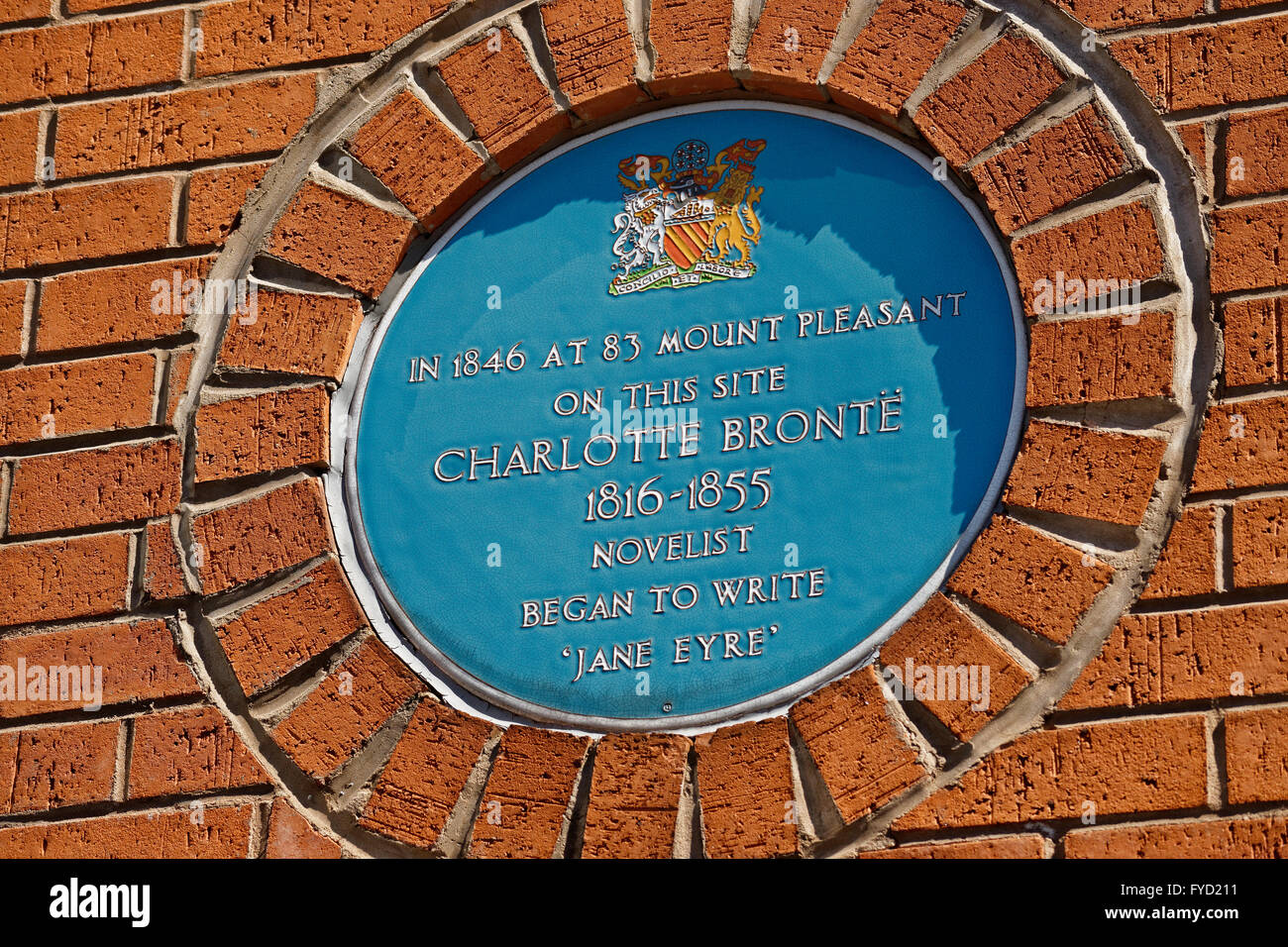 Commemorative blue plate at Hulme, Manchester, celebrates where Charlotte Bronte wrote the early parts of her novel - Stock Image