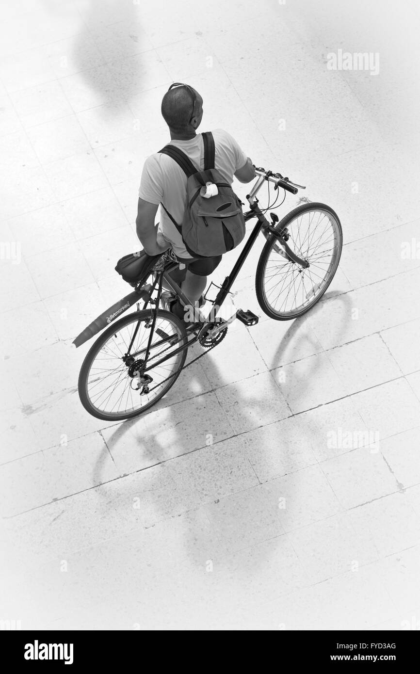 Cyclist at London Waterloo Station. - Stock Image