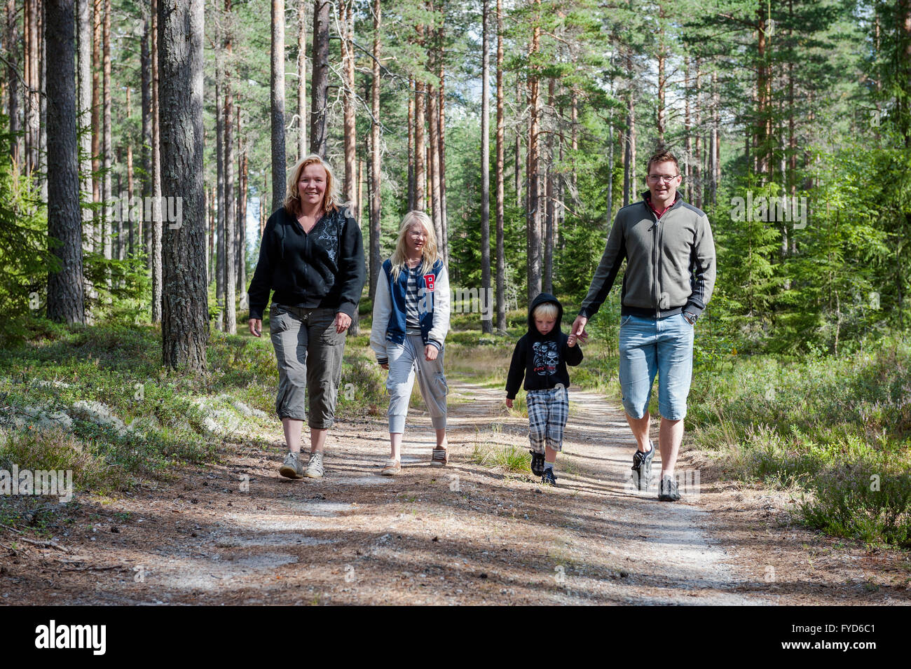 Family on forest walk, Sweden Stock Photo