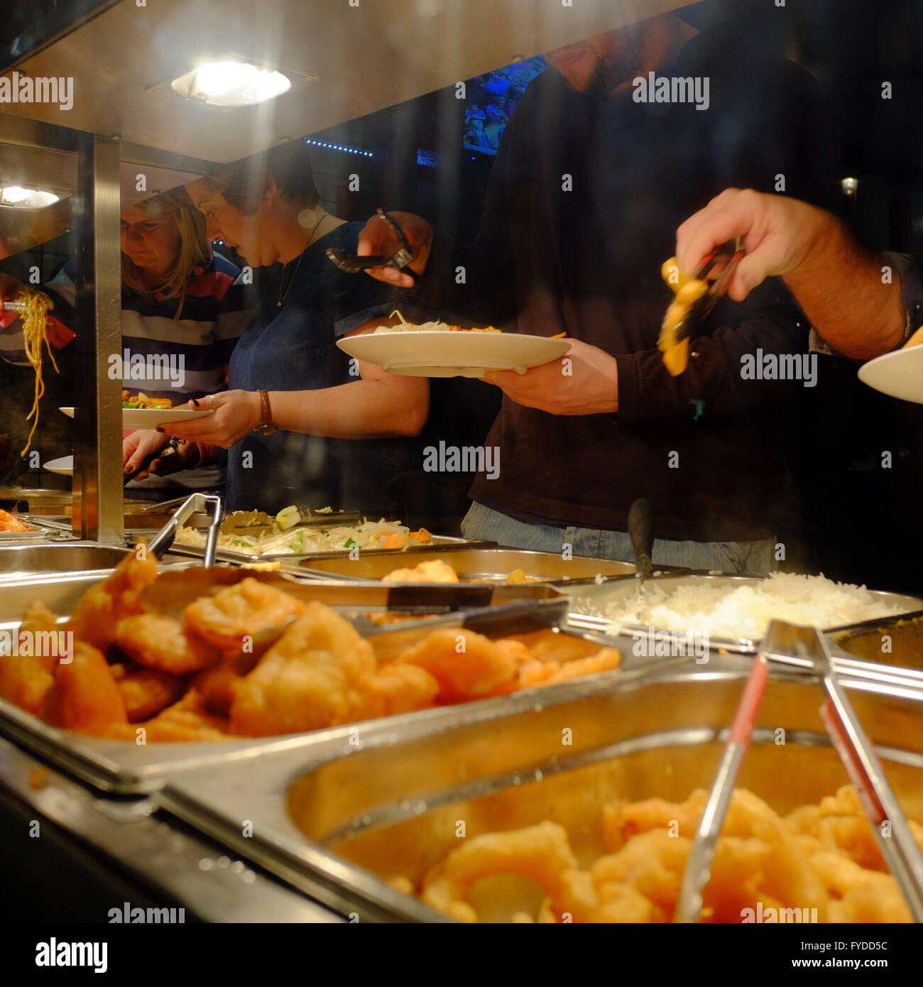 people serving themselves at a Chinese Buffet Restaurant in Soho, London, England - Stock Image