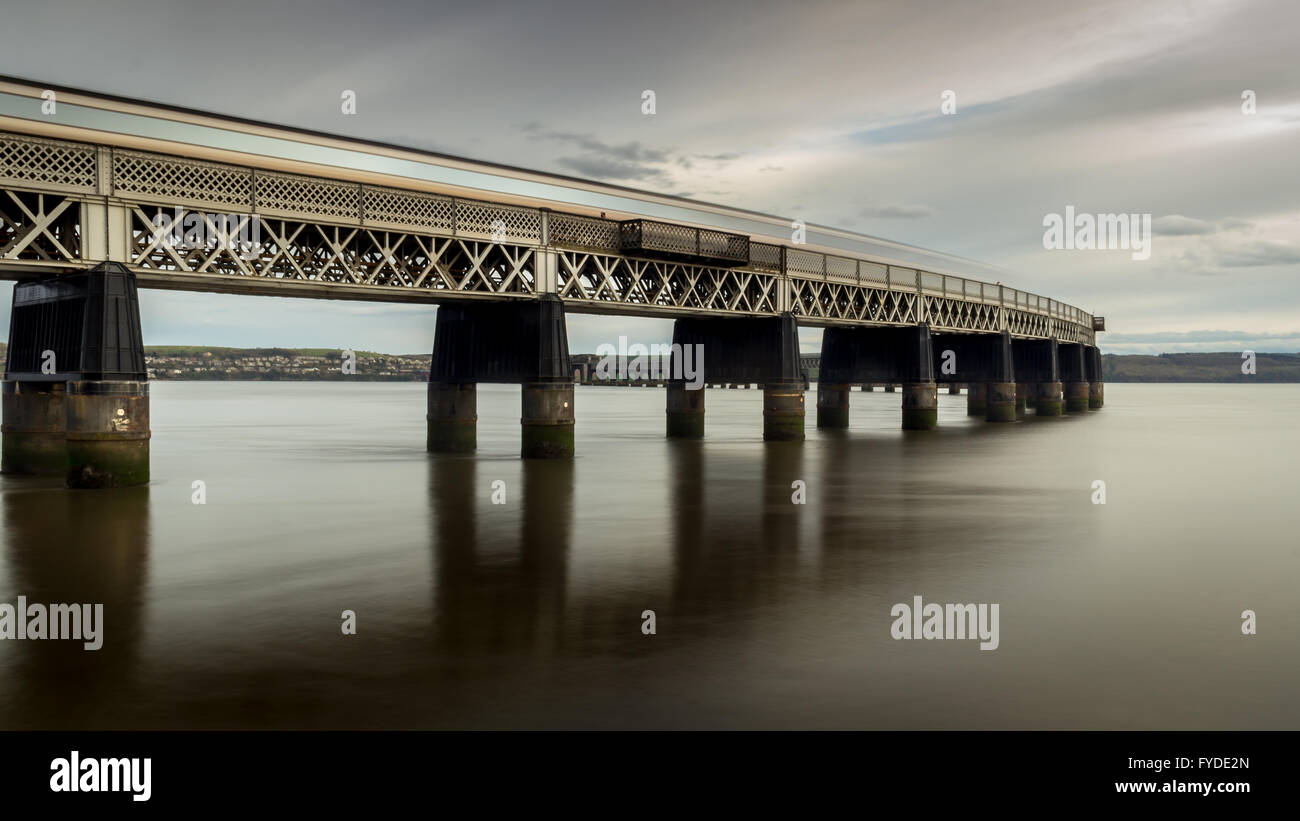 A long exposure of a train crossing the Tay rail Bridge - Stock Image