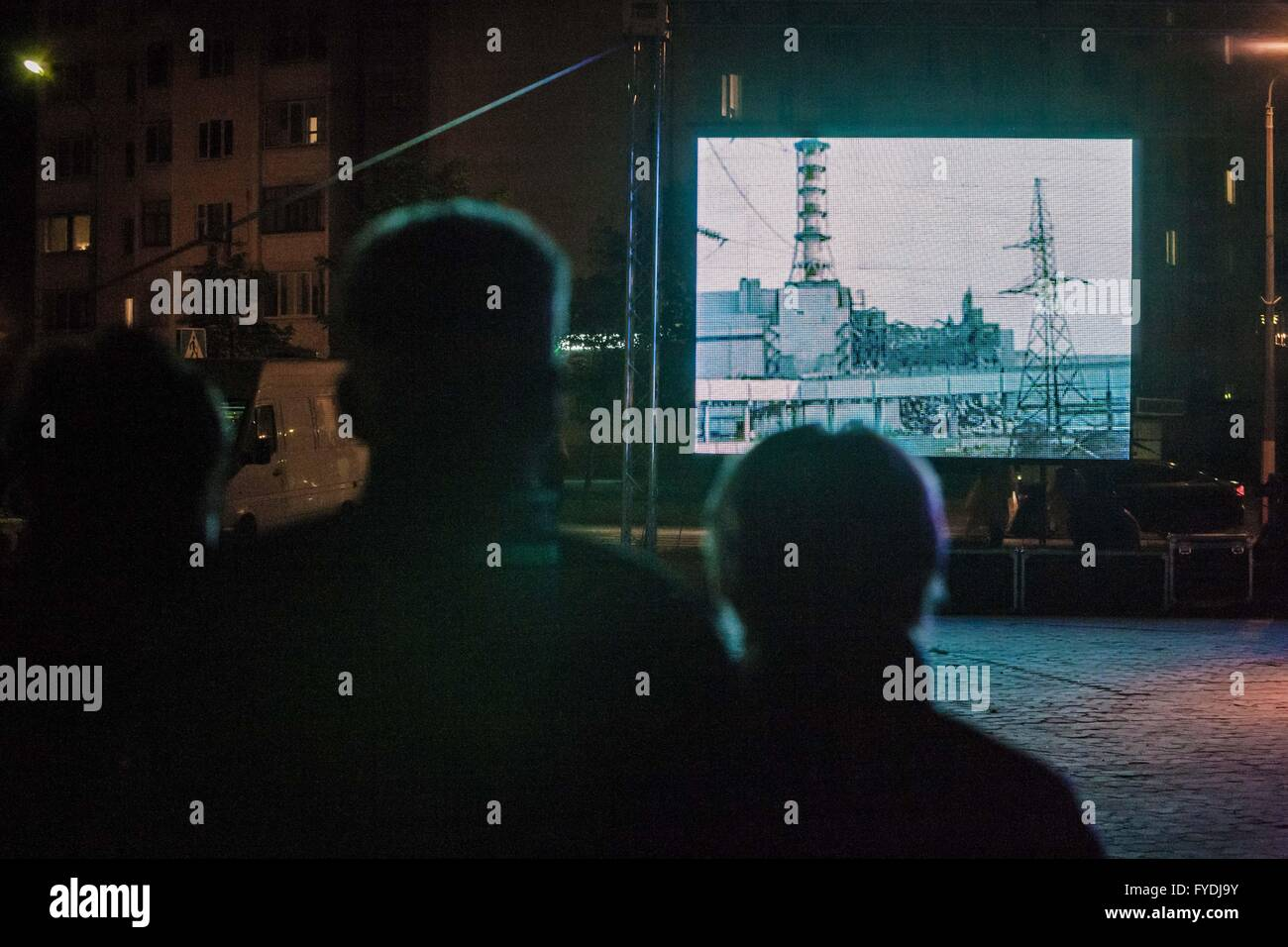 Slavutych, Kiev, Ukraine. 25th Apr, 2016. People watch an outdoor video of the Chernobyl disaster during the ceremony - Stock Image