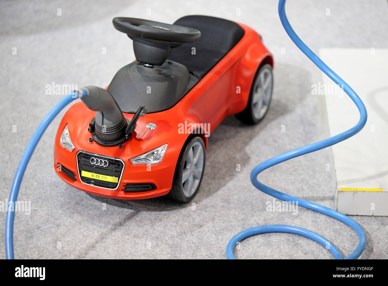 an audi bobbycar with a charging plug of an electrocar. Black Bedroom Furniture Sets. Home Design Ideas