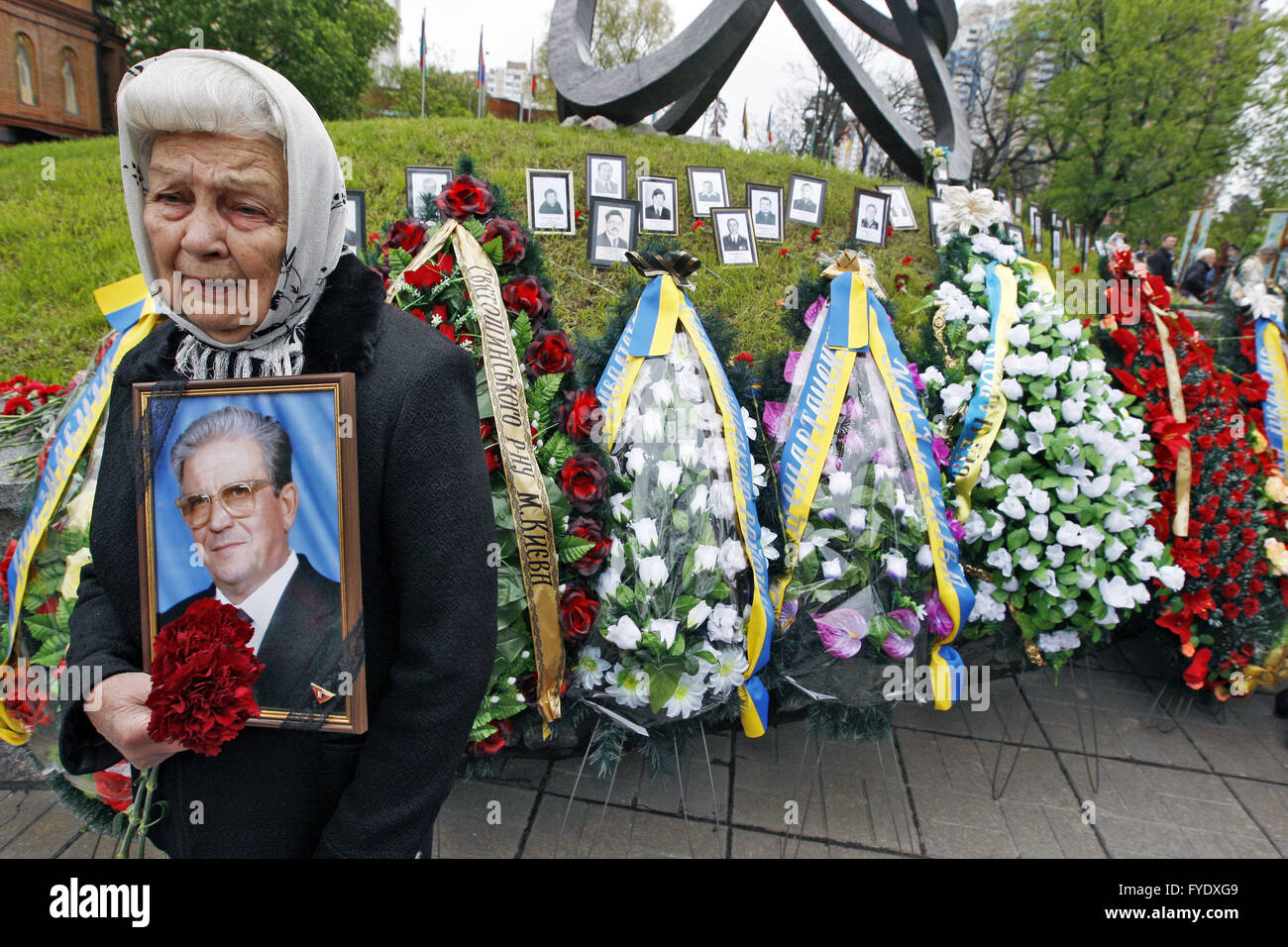 Kiev, Ukraine. 26th Apr, 2016. A woman holds a portrait of her died husband, a victim of the Chernobyl nuclear disaster, - Stock Image