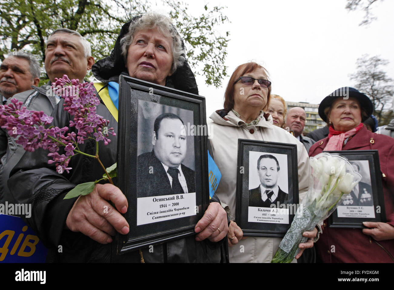 Kiev, Ukraine. 26th Apr, 2016. Womans holds portraits of died relatives, victims of the Chernobyl nuclear disaster, - Stock Image