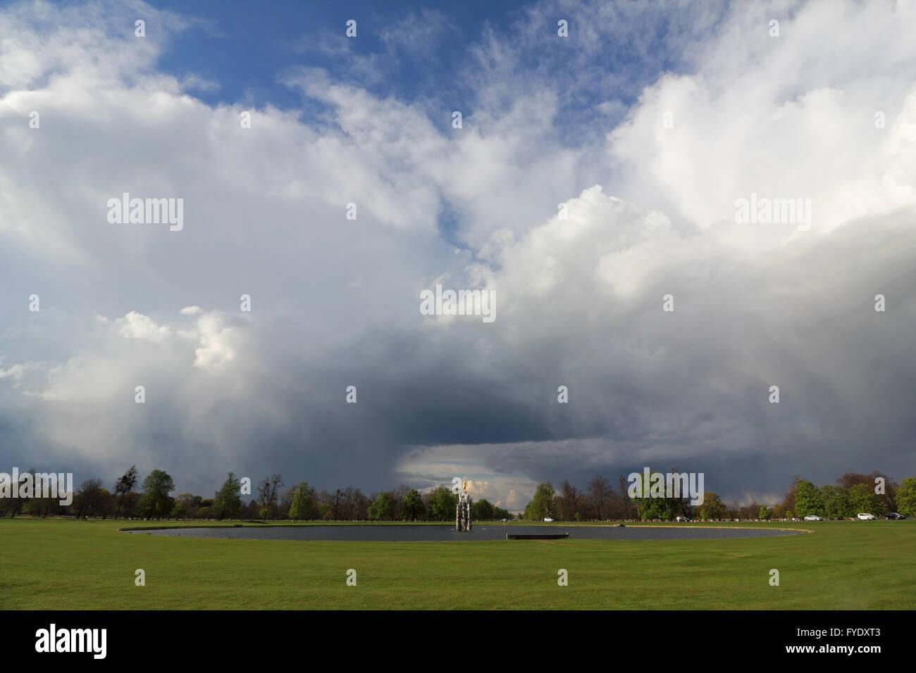 Bushy Park, London, UK. 26th April 2016. UK Weather: Huge cumulonimbus clouds pass over the Diana Fountain in Bushy - Stock Image