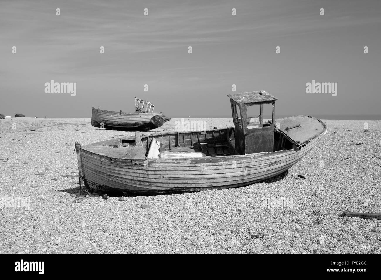 Disused fishing boats on the shingle beach at Dungeness near Lydd in Kent on the Romney Marsh - Stock Image