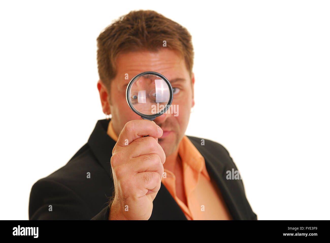 Bussiness man holding a magnifying glass - Stock Image