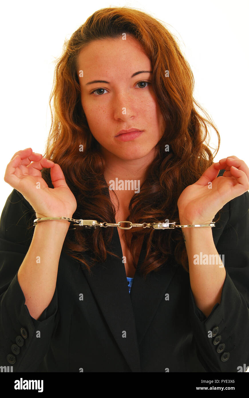 Businesswoman in handcuffs - Stock Image