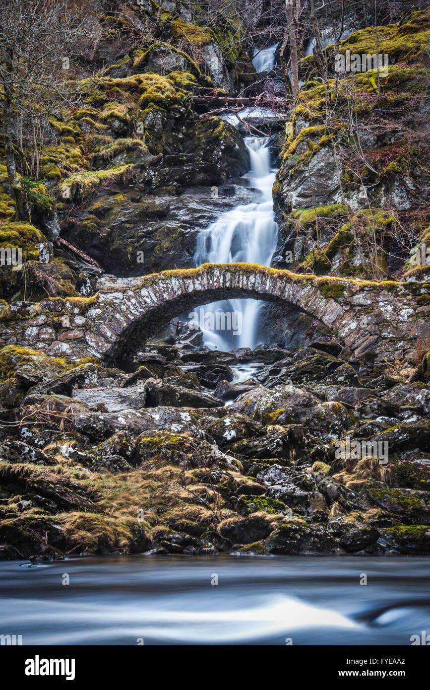 Roman Bridge in Glen Lyon Scotland, an old packhorse bridge - Stock Image