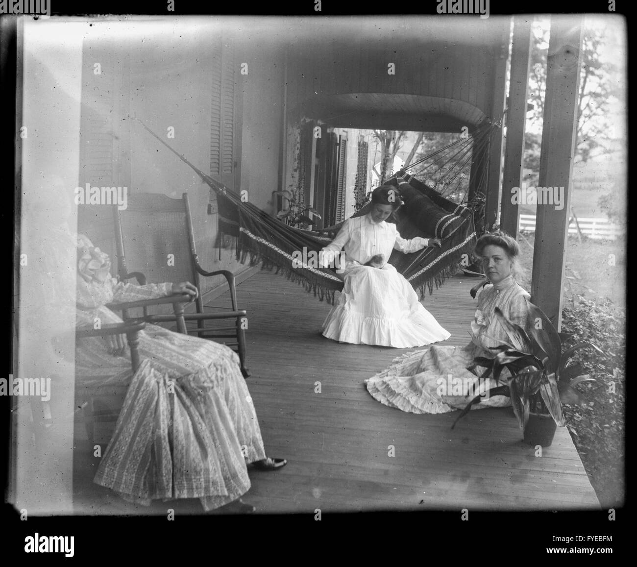 Victorian photograph of women on a porch with a hammock in Fallston, Maryland. - Stock Image