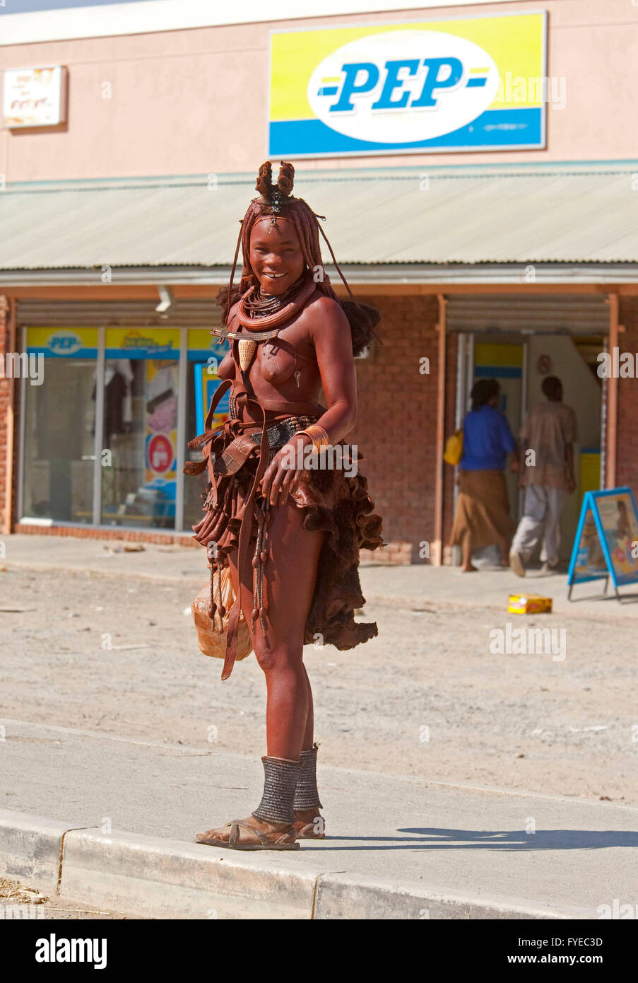 THE HIMBA are a nomadic people of Namibia. They adorn themselves with leather collars and brass rings and coat their - Stock Image