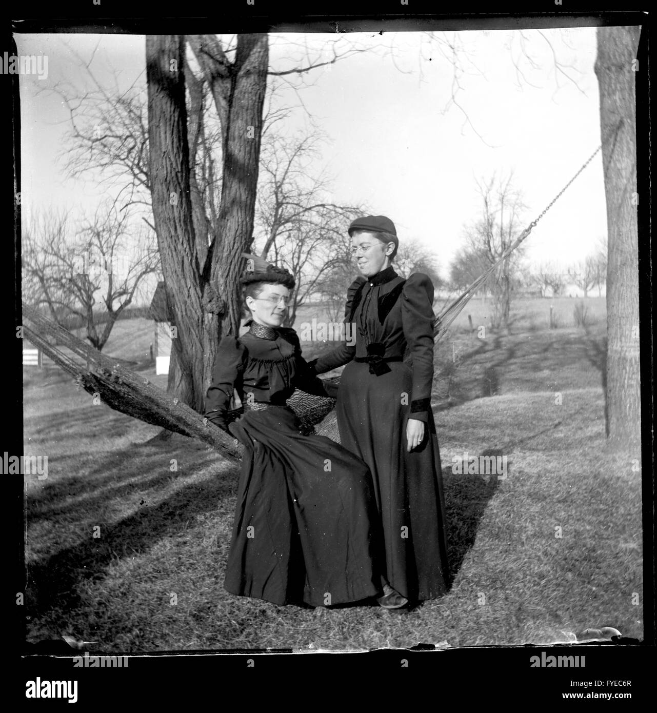 Victorian photograph of two women with a hammock outside in Fallston, Maryland. - Stock Image