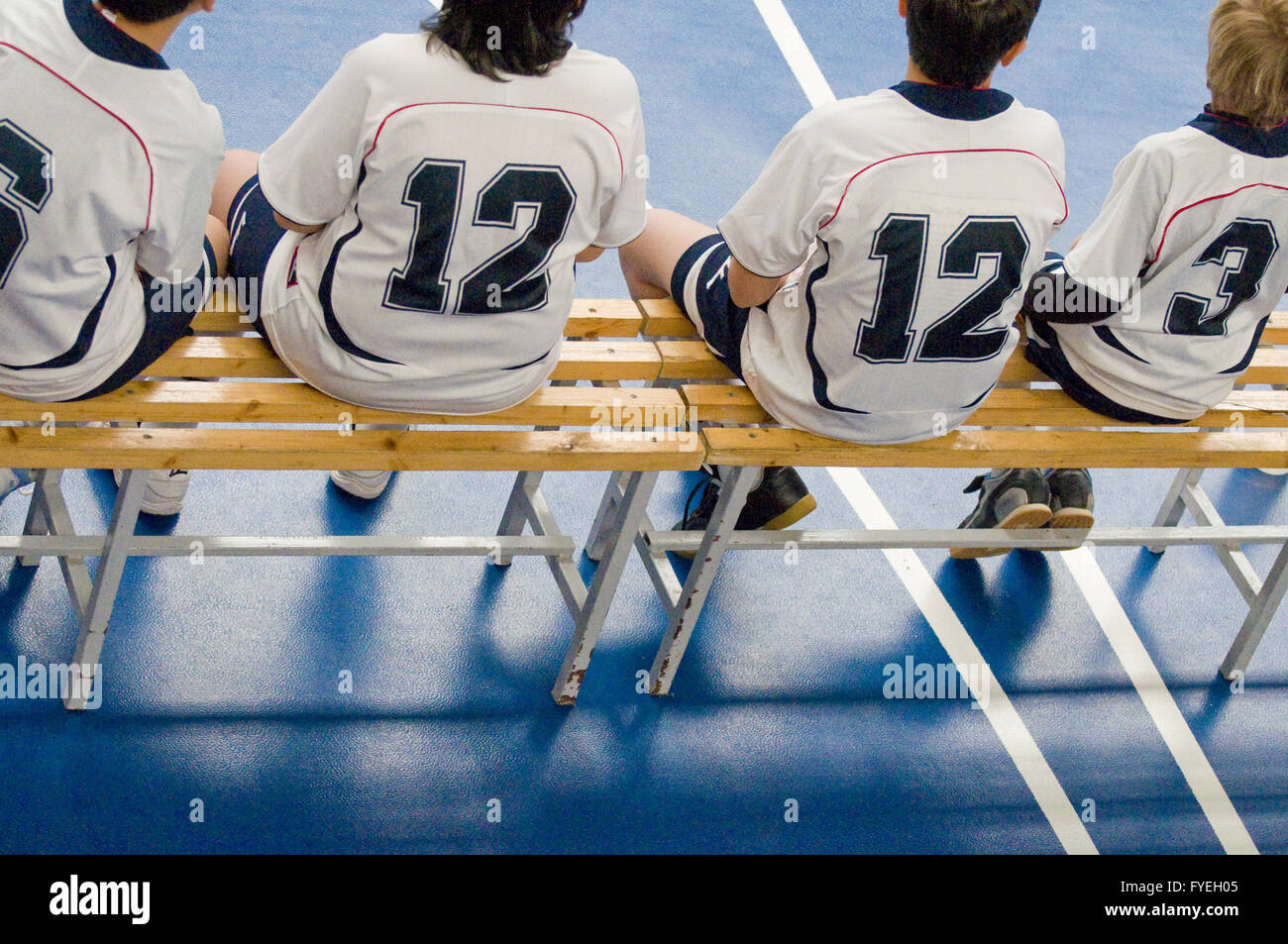bench with young athletes - Stock Image
