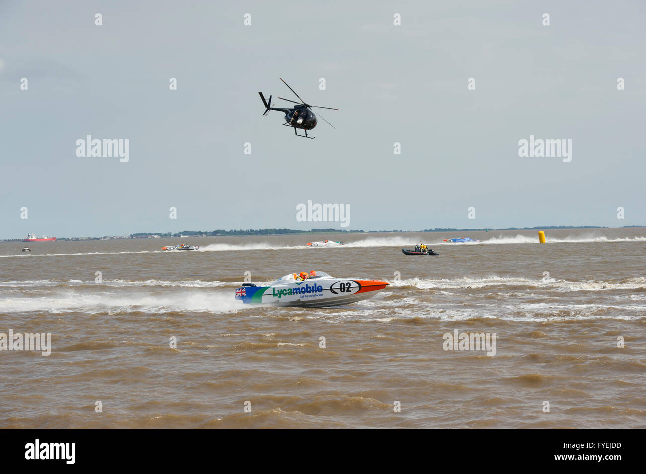 P1 Superstock powerboat racing along the Humber past the Marina in the city of Hull being filmed from a helicopter - Stock Image
