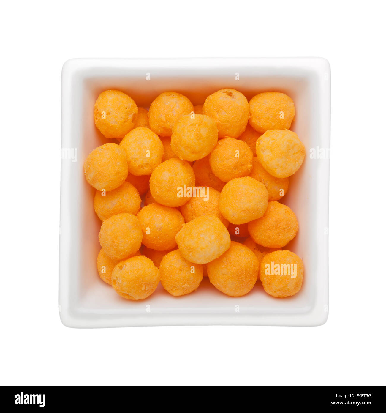 Cheese flavor corn snack in a square bowl isolated on white background Stock Photo