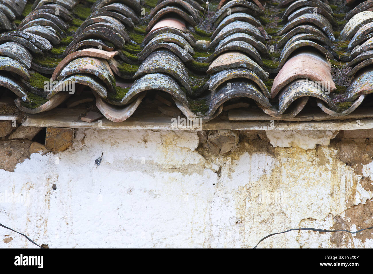 old and worn tiles on typical Spanish house - Stock Image
