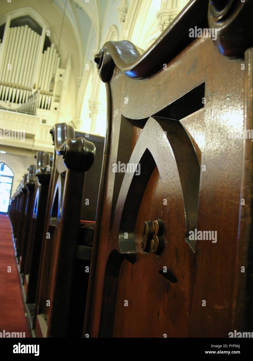 Church organ and pew - Stock Image