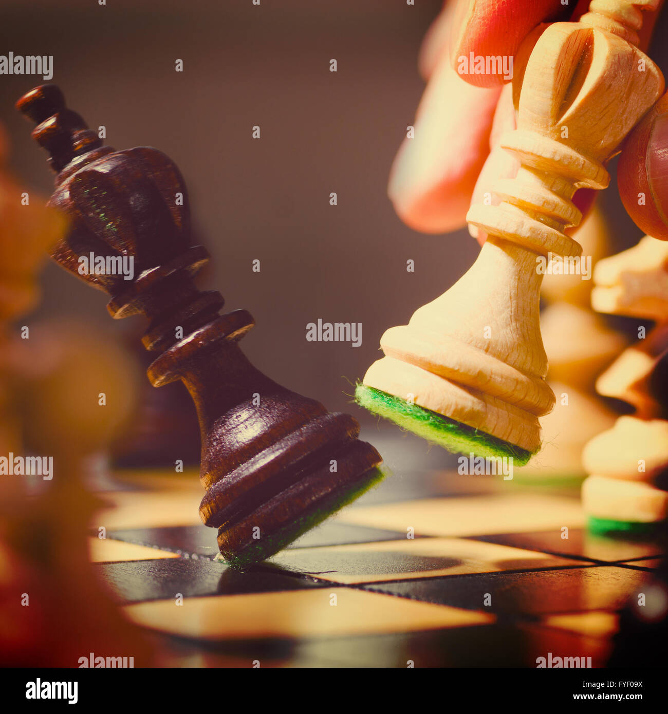 playing wooden chess pieces - Stock Image
