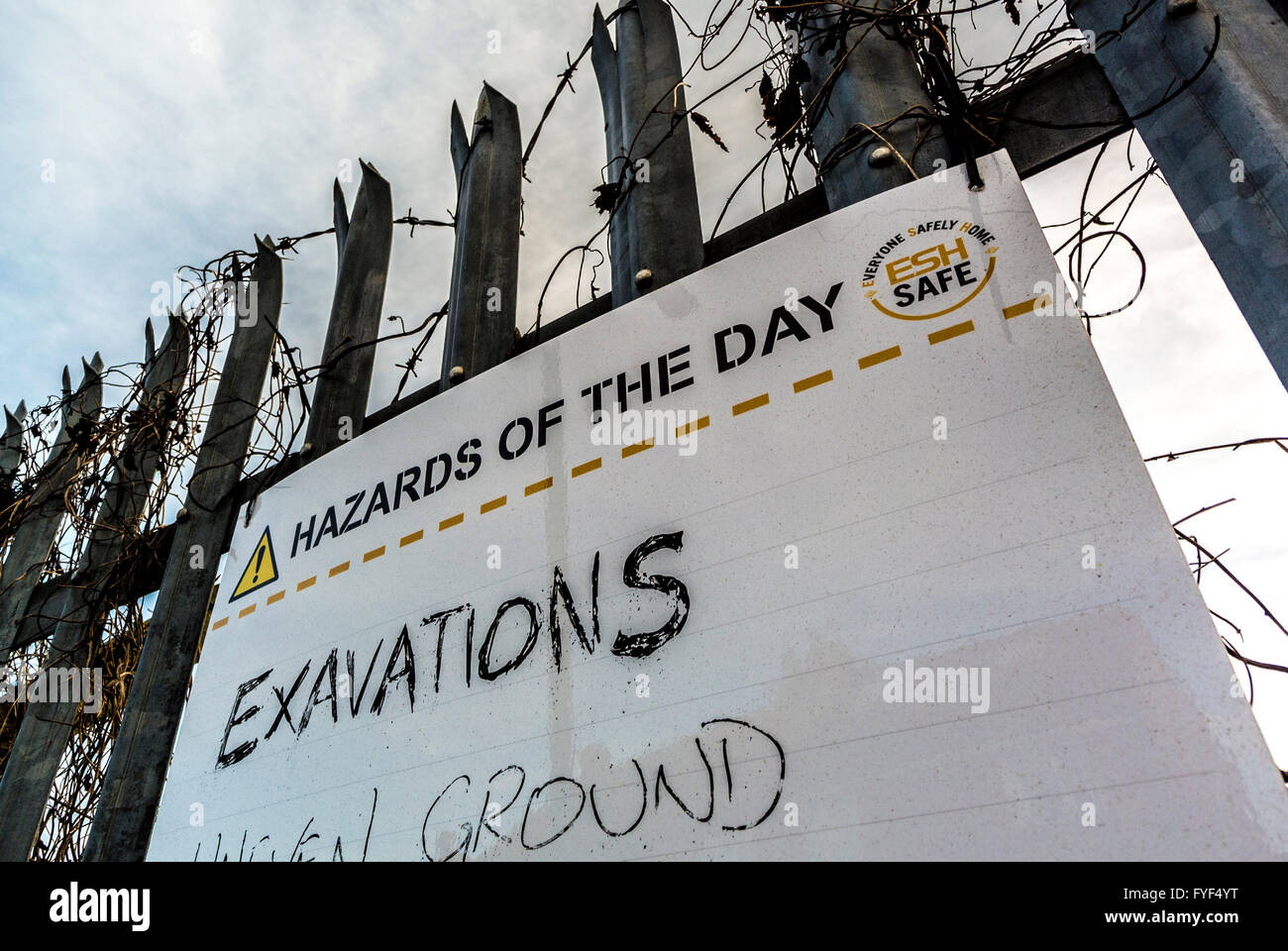 Hazards of the day sign on building site with mispelled word Exavations (Excavations) - Stock Image