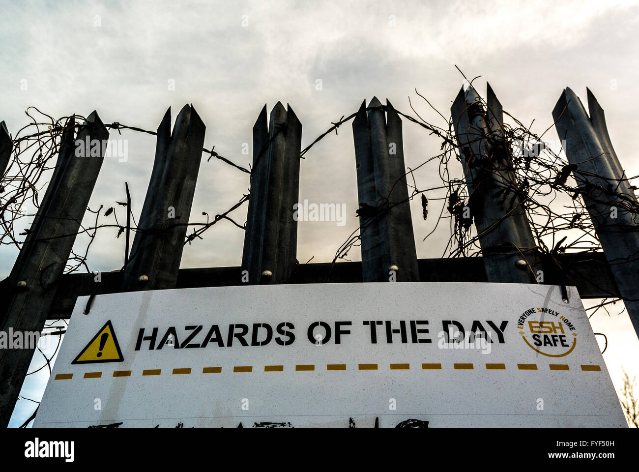 Hazards of the day sign on building site - Stock Image
