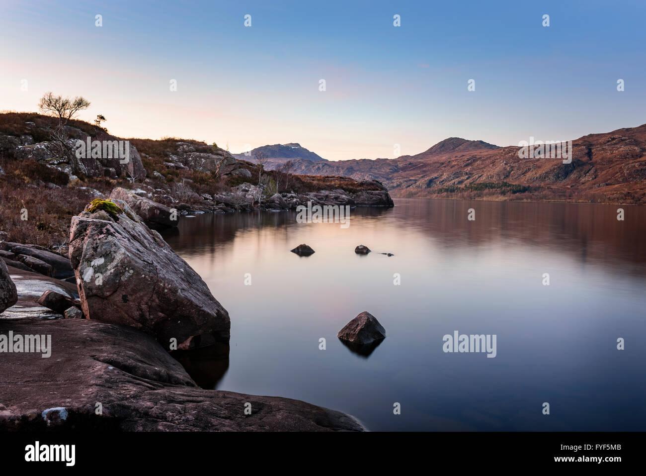 Loch Maree at dusk. - Stock Image