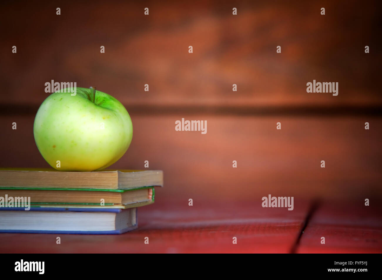 Apple on pile of books. Education concept Stock Photo