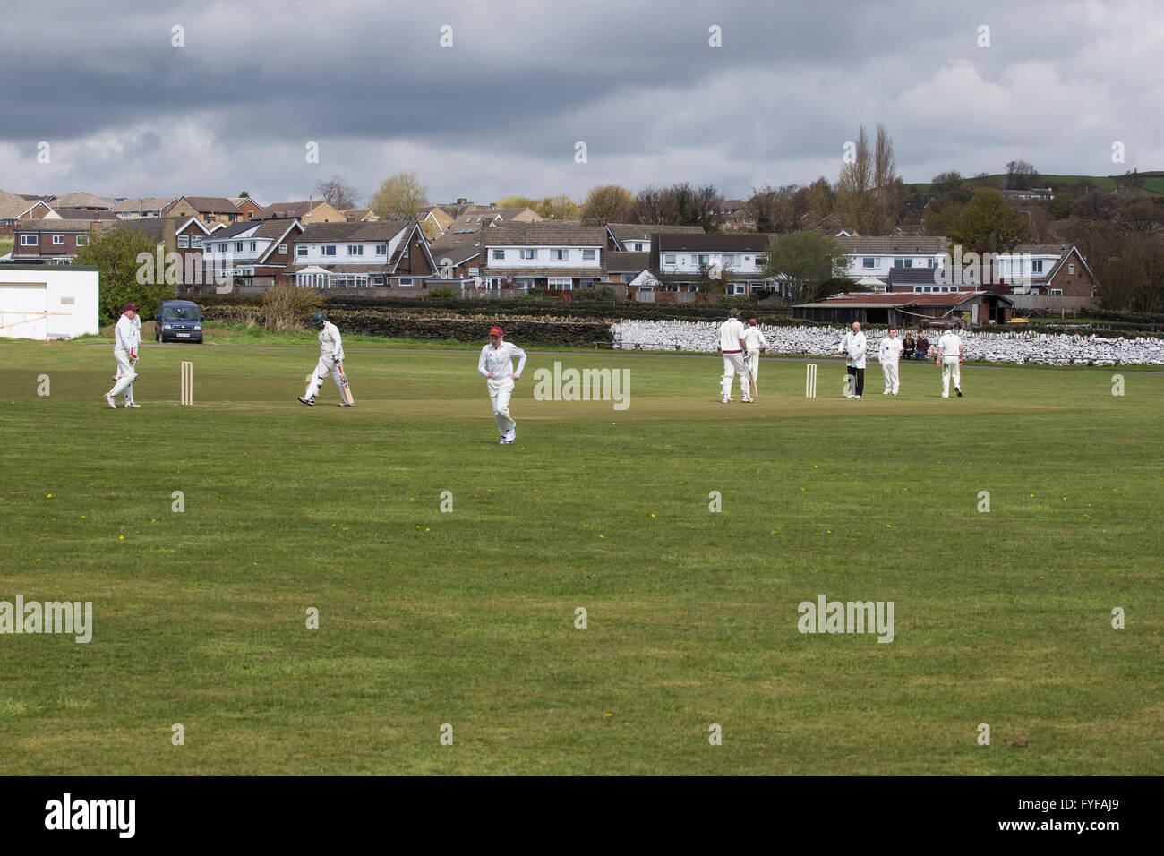 English game of cricket being played on a local village ground Stock Photo