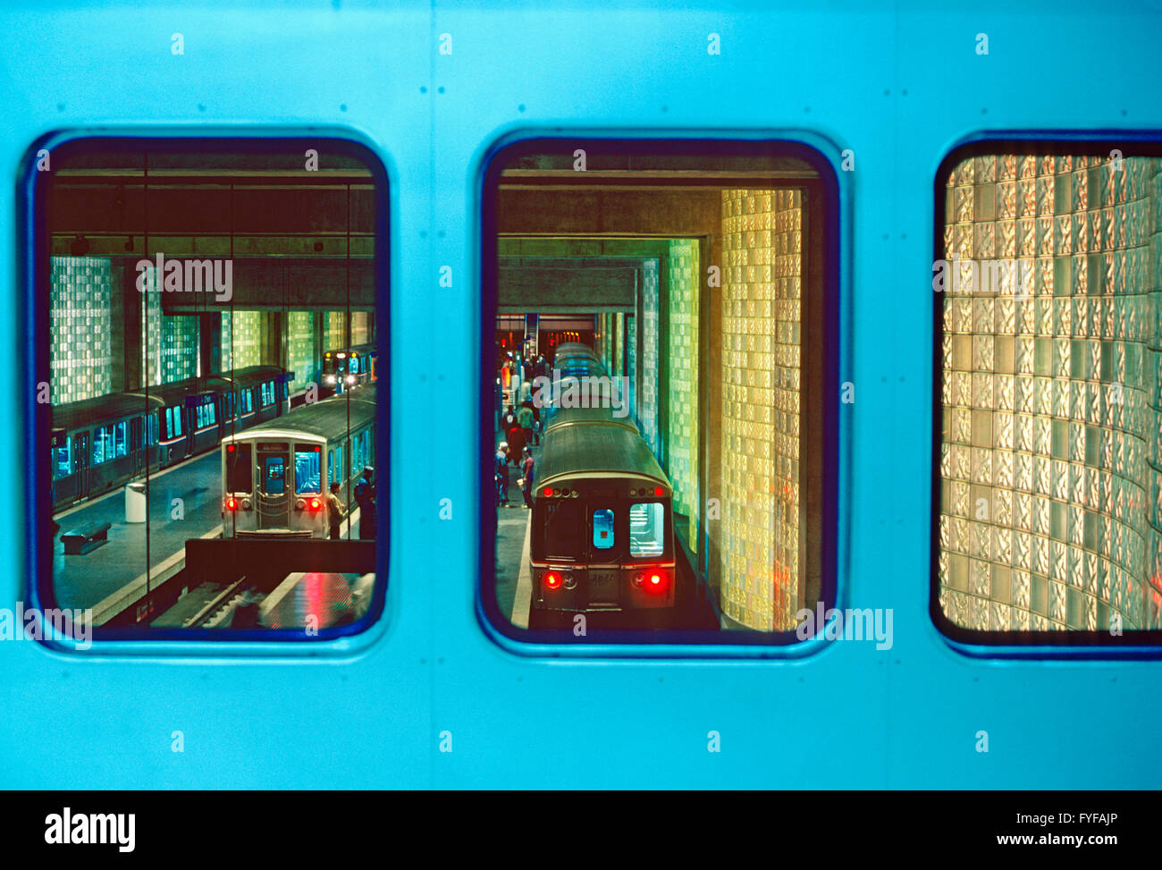 Subway station, train car & block glass walls at Chicago's O'Hare International Airport - Stock Image