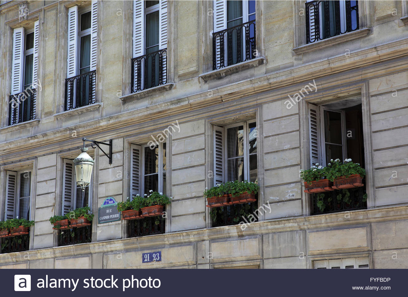 Shuttered windows in Rue Casimir-Perrier Paris on a spring day. - Stock Image
